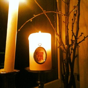 "Picture of ""geek for life"" sign on burning candle"