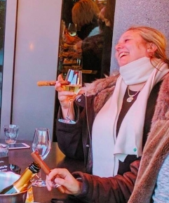 Linn Sovig smoking cigars and drinking champagne